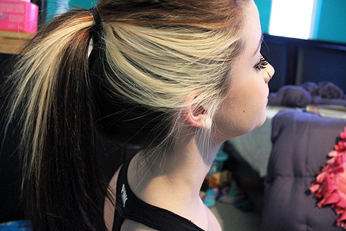I love this! Blonde side streak on darker colored hair! So cute & unique. Looks like my hair!