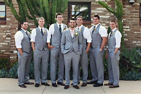 Definitely a fan of the no jacket/only vest and tie look for the groomsmen and a jacket for the groom.