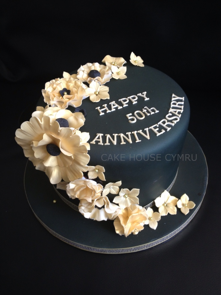 50th Wedding #Anniversary Cake - Gold flowers set off against a black background