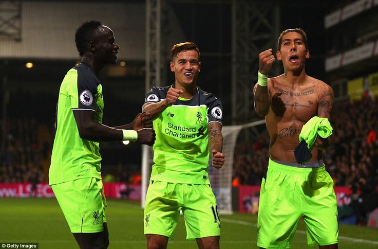 Roberto Firmino (right) celebrates with Philippe Coutinho and Sadio Mane after scoring Liverpool's fourth goal