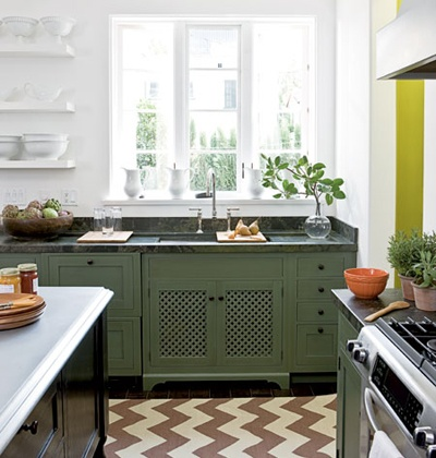 Great design. Large window, opens shelves, soapstone countertop, lattice panel on cabinet and chevron rug.