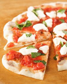"This simple and delicious pizza margherita is courtesy of chef Mario Batali and can be found in his cookbook, ""Italian Grill."""