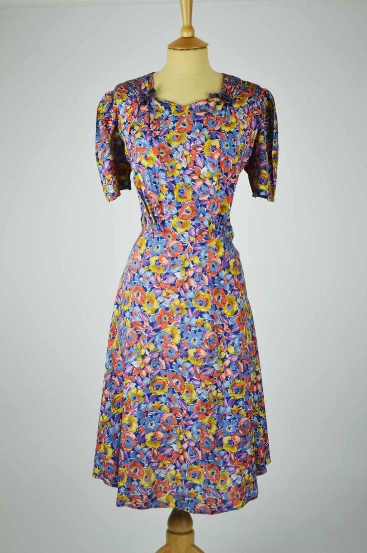 1930s Vintage Dress Multi Coloured Floral Print with Ruched Neckline & Velvet Bow Detail (26 Waist) http://www.melamela.co.uk/vintage-womens-clothing/vintage-dresses/vintage-1930s-dresses/1930s-vintage-dress-multi-coloured-floral-print-ruched-neckline-velvet-bow-detail.html#.VIgyBGdybmQ