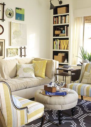Tiny living room but I love it! A smaller sofa, two chairs, a small round ottoman and tall bookshelves ~ Genius!