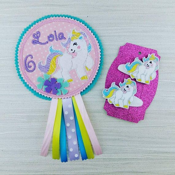 Unicorn Birthday Badge - Unicorn Party Badge These Birthday Badges are made to order.  You will be purchasing one to your specifications not this one for Lola  When completed they measure approx 5.5 so are quite large but can be made up in fabric or felt and in any colours that you require too.  This one is with a Unicorn theme  There is a brooch backing on the back, if you would like this removed and replaced with a ribbon so you may hang the rosette please just add a note on your order…