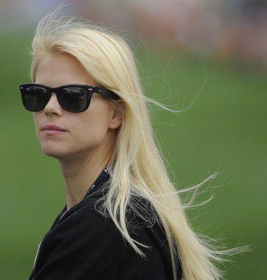 Elin Nordegren, wearing Ray Bans.  I want ray bands like her too.. haha.