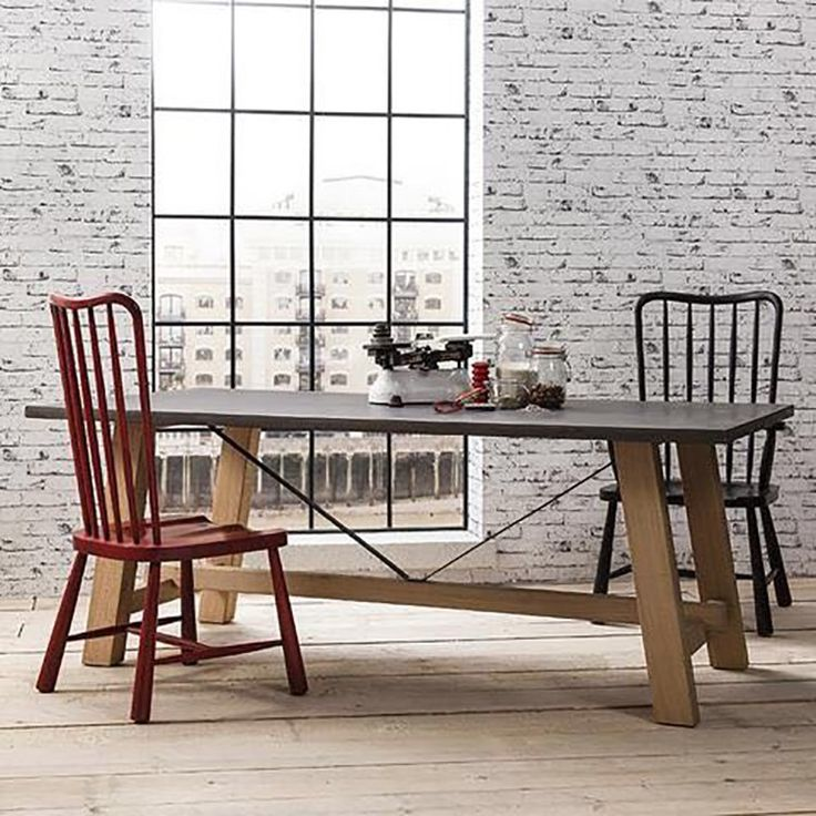 The Tribeca dining table seats 8 and features a hand finished concrete surface