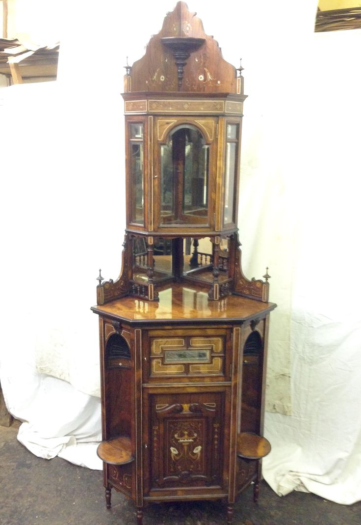 Decorative rosewood corner cabinet veneered with Marquertry and bone inlays