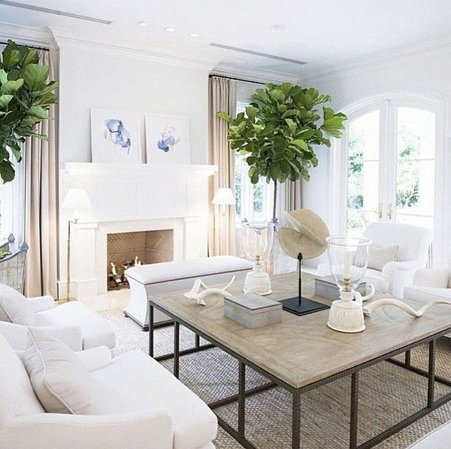 Beach House Living Room With White Walls Linen Draperies Furniture And Neutral Coastal Decor Via The Real Houses Of Ig