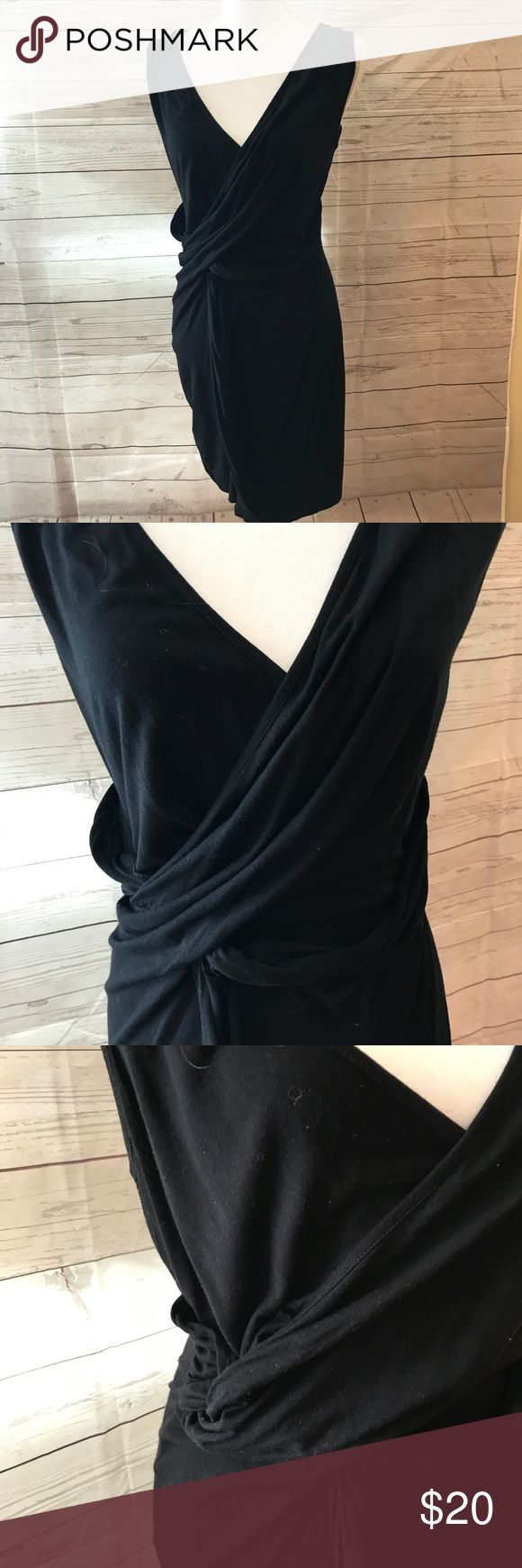 Asos petite black wrap dress lbd size 10 Crossover wrap style dress, fun twist detailing on hip. Stretchy. Good used condition. About 35 inches long ASOS Petite Dresses