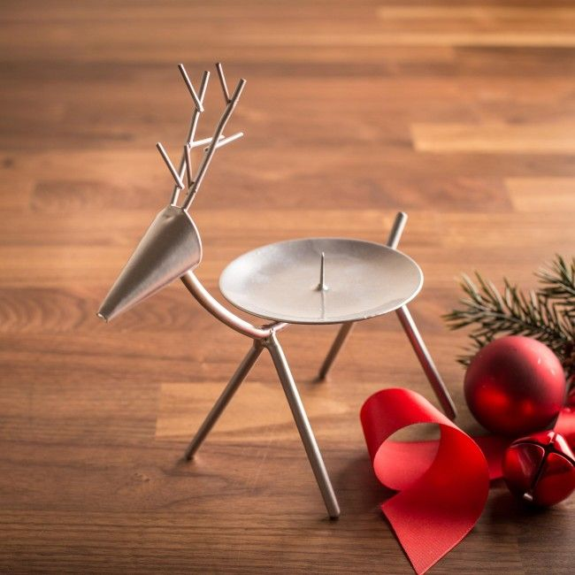 Spruce up your home and your holiday candles with the Prancer Iron Pillar Candle Base.