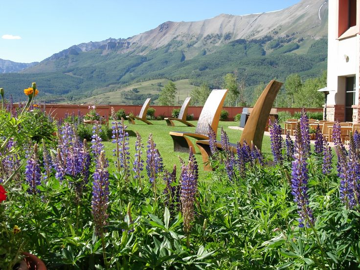 "Art is a perfect medium for translating past, present and future into something tangible we all can enjoy.  In this photo from 2006 of James Vilona's ""Jetson Charis"" in the garden at Telluride Spa, we love how the past present and future are all represented.  (Past = Jetsons TV show inspiration 