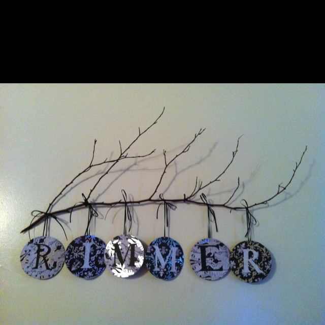 Letters made from old CD's covered with scrap paper.  Use any word...I'm making one of these for the laundry room!