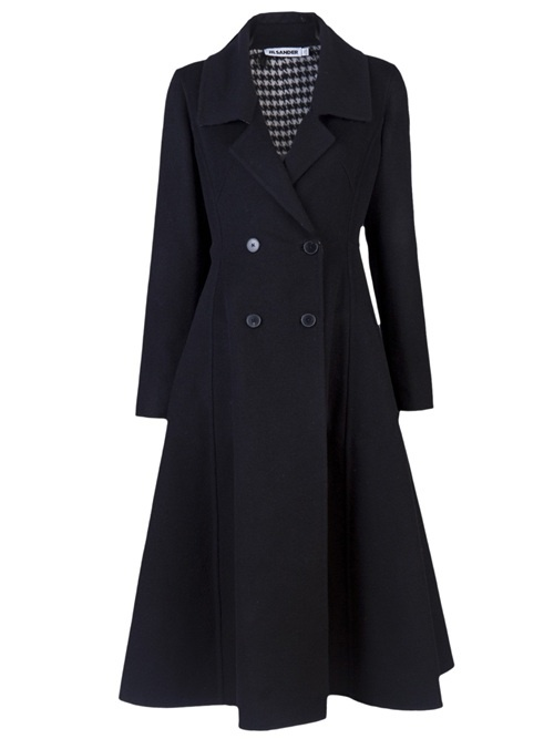 Manila long coat in black from Jil Sander. This wool coat features notched lapels, long sleeves, double breasted closure, single slit in the back center and a black and white geometric lining.