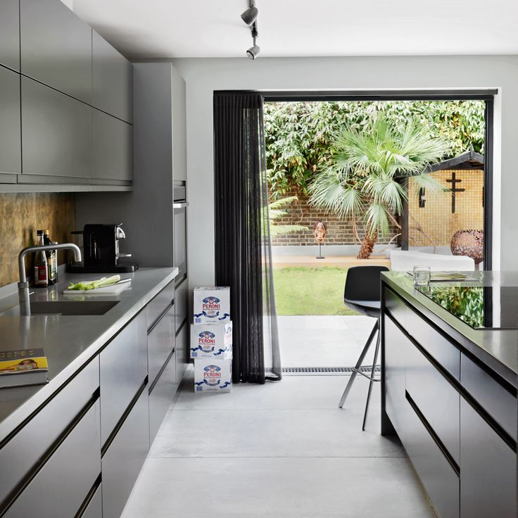 Take your summer gatherings up a style notch with a beautiful modern kitchen that's perfect for parties. Include some statement seating and blend the inside/outside space with a foldaway door.