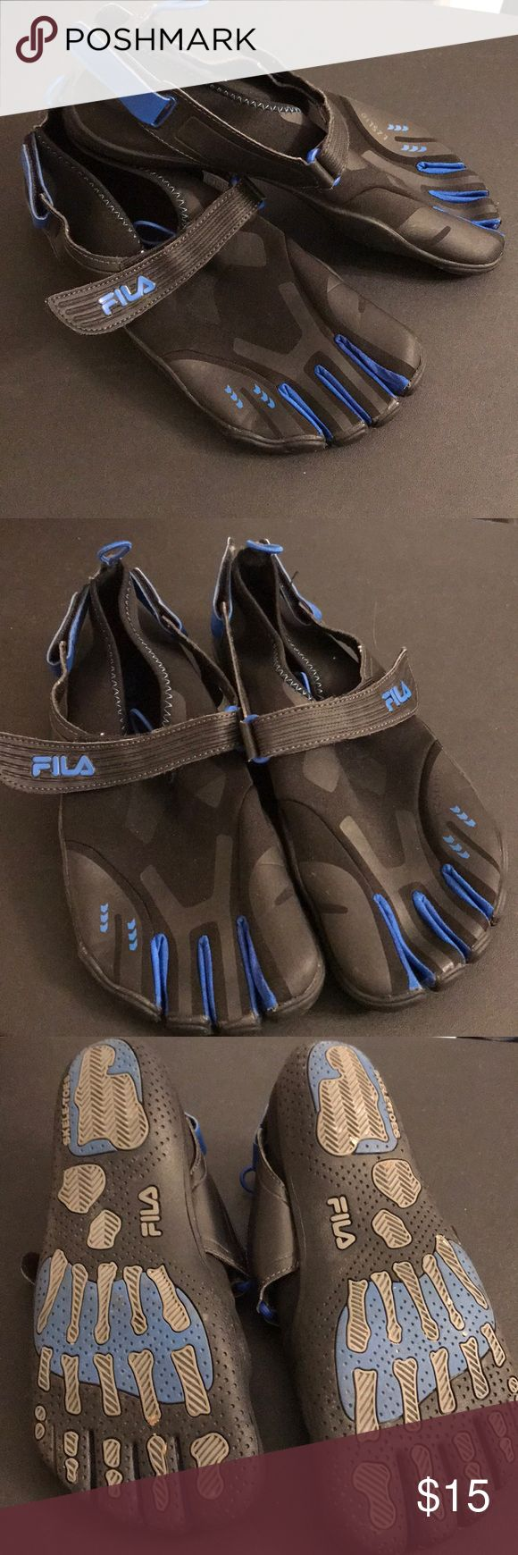 Men's Fila Toe Shoes A pair of black and blue toe shoes for men. These shoes have been worn a few times but are in good condition. They are perfect for any activity. Fila Shoes