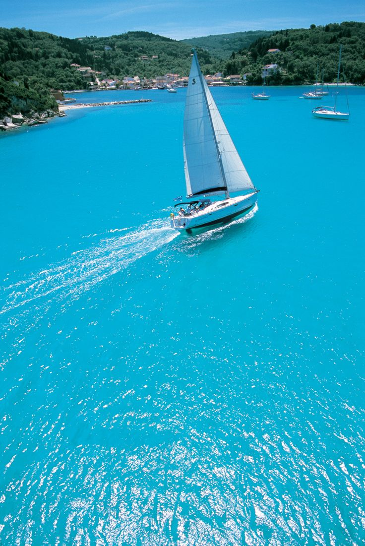 Our Beneteau 50 'Kassandra' cruising into Lakka Bay at the top of Paxos...
