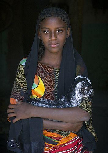 Fatouma Mahammed, Afar Girl Tribe With A Kid Goat, Afambo, Ethiopia | by Eric Lafforgue