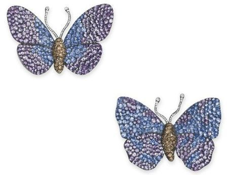 This pair of brooches is made by ultra-exclusive jeweler Joel Arthur Rosenthal, know as JAR, considered by many as the most talented jewelry craftsman alive. These butterflies have circular cut sapphire and amethyst wings, with a pave-set colored diamond body, with a single-cut diamond antenna. The amazingly fluid blend of colors achieved by the tight-knit stones is a showcase of JAR's signature pavé technique. They are mounted on silver and gold and come with a signed JAR red leather case.
