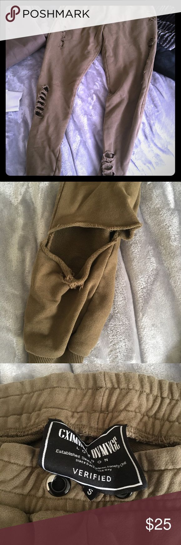 Criminal Damage Olive green distressed sweatpants This one is size small and olive colored. Bought in england at their store. Not sold anymore from criminal Damage! Has small rip on right leg back of leg as pictured so you can see. And string is missing as seen in pics. Offers welcome and bundle up with my matching items for a whole outfit! Condition of item is reflected in price. 💰Bundle for extra savings!💰 Criminal Damage Pants Track Pants & Joggers