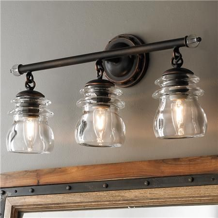 Something like this above sink in mudroom?  Insulator Glass 3-Light Bath Light