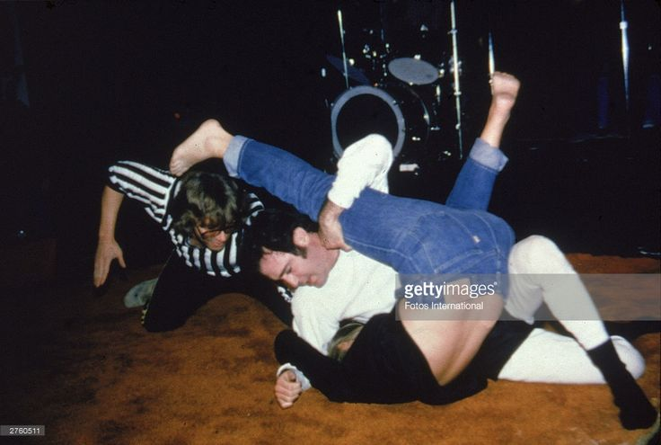 American comedian Andy Kaufman (1949 - 1984) pins Elizabeth Hocker to the mat during a wrestling match as a referee gives the count, at the Comedy Store nightclub, Los Angeles, California, December 1979.