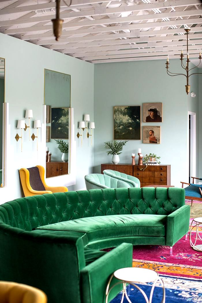 Tufted green sofa in modern living room