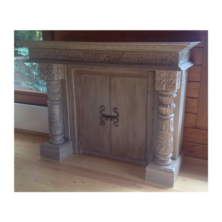 Fireplace frontage turned into a beautiful cabinet