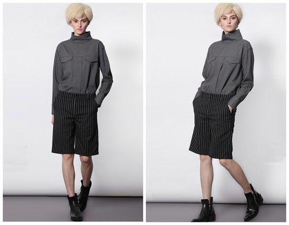 Grey high collar shirt for women from BWG studios.