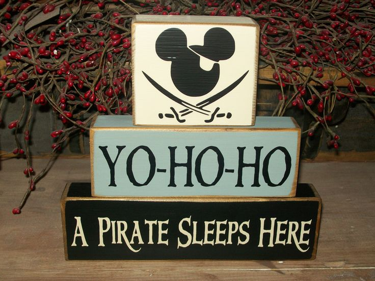 Yo-ho-ho  A pirate sleeps here..New Pirate Mickey Mouse Primitive Wood Sign Blocks Kids Nursery Room, via Etsy.