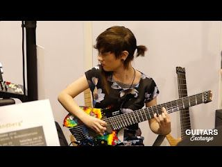 Sarah Longfield: Strandberg Guitarworks NAMM2016.   Sarah Longfield played some notes on a cool Strandberg guitar at The NAMM Show 2016. NAMM2016. Sarah Longfield & Strandberg Guitarworks Sarah Longfield