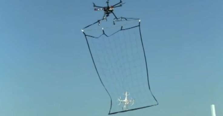 Tokyo Metropolitan Police Department Is Launching A New Squad Of Officers Who Will Operate A Net Wielding Drone Designed To C Drone Design Drones Concept Drone