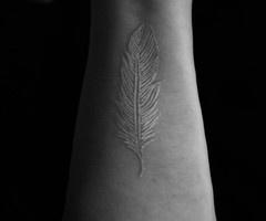 White tattoo...