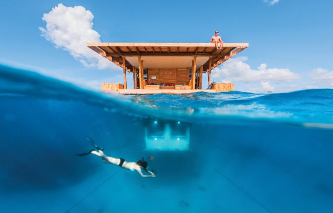 The Manta Resort, Zanzibar, Tanzania: On your next trip to Zanzibar, consider booking The Manta Resort's Underwater Room. It's one of the few places that perhaps earns the overused tag 'unique,' – choose to lie upstairs on deck watching the stars, or head to your bedroom downstairs where you'll be surrounded by ocean on all sides.  #Tanzania #Underwater #TurqouiseBlue