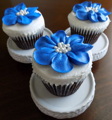 Chocolate cupcakes, filled with peanut buttercream, iced with vanilla buttercream and decorated with royal blue buttercream flowers and edible pearl centers delivered at the Peter Allen House in Dauphin PA