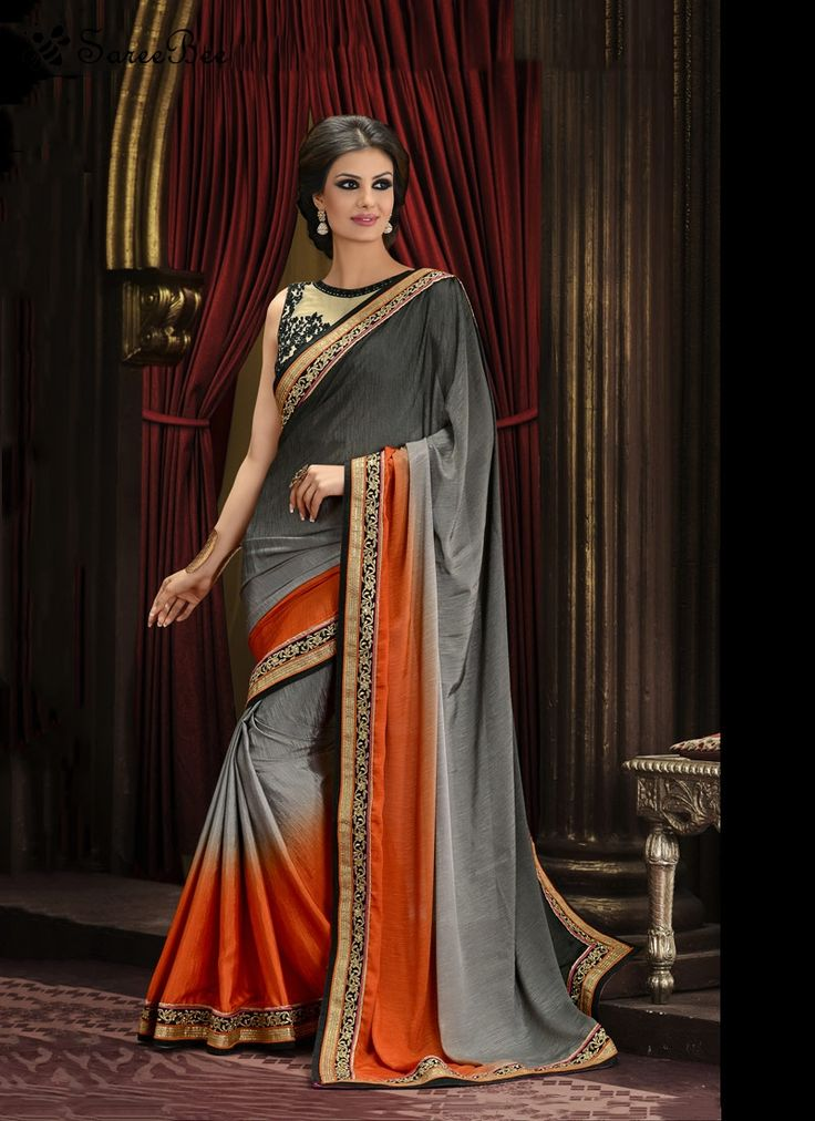 Tiptop Grey Art Silk Designer Saree  Be the dazzling diva clad in this grey art silk designer saree with exquisite designs and patterns. This pretty attire is showing some brilliant embroidery done with embroidered and patch border work. Comes with matching blouse.