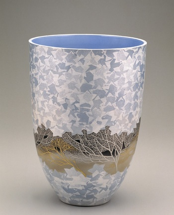 Vase with design of a grove of trees  1992    Taka Akira , (Japanese, born 1936)   Heisei era     Porcelain with silver leaf under blue glaze, platinum and gold enamels over glaze  H: 39.7 W: 28.3 D: 28.3 cm   Komatsu city, Japan