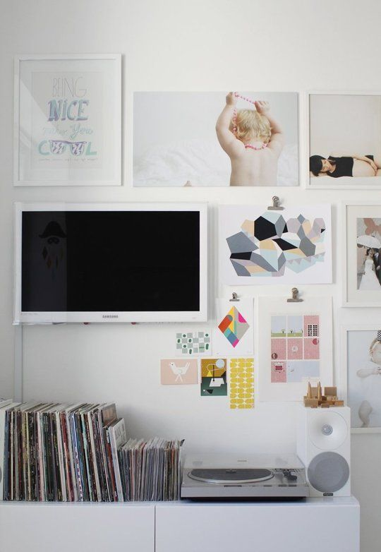 Love the TV as part of the gallery wall | 9 Ways to Decorate Around a TV | Apartment Therapy
