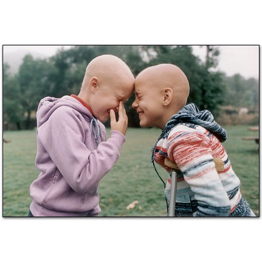 This photographer seriously gets me. 100% weddings and family pictures are fine and dandy but THIS is what speaks to me the most. 2 children at a camp for cancer patients.