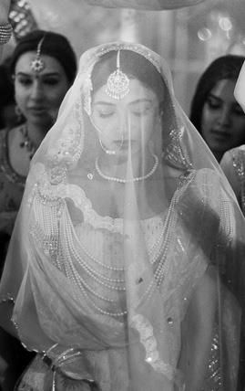 the colonized eastern bride. white dress and pearls