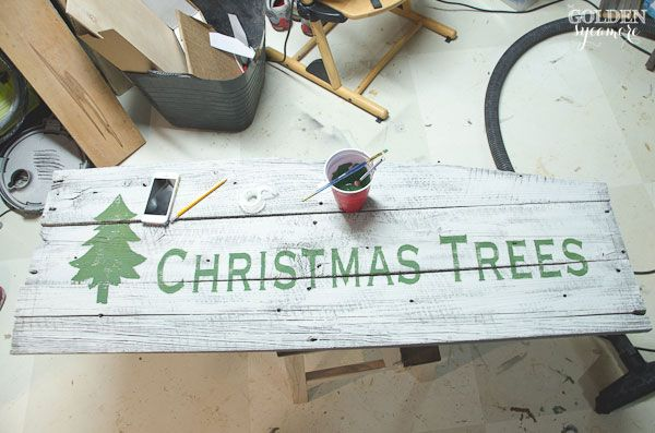 Making a Christmas tree sign out of reclaimed barn wood - thegoldensycamore.com