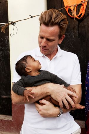 Ewan McGregor holds nine-month-old Priyashen,who was born weighing less than two pounds, dangerously underweight. Thanks to the treatment she received at a UNICEF-supported care unit, Priyashen is now a happy, healthy baby.