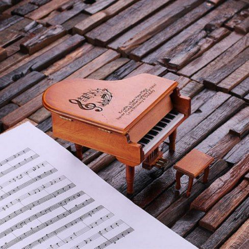 Custom Cherry Wood Miniature Baby Piano Music Box Music and Jewelry Box For the Piano Darling! This miniature dark wood baby piano gift is both outstanding and beautiful in its simplicity. It comes with a miniature chair and details of an authentic baby grand. Look at the charming gold -tone foot pedals! We engraved to show what a marvelous gift it would make for the piano protege in your life. Engrave it as you wish, with your message, name, or specifications. #ad