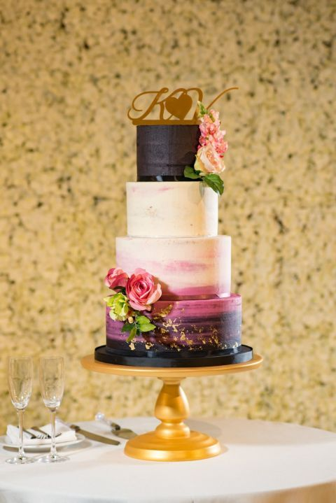 Color-Block Cake: Starting with darker shades on the top and bottom tiers, the colors dissolve into a dreamy fuchsia and butter creme combo. Krishma Maya Mandalia of Maya Dahlia Cakes added gold flakes to give this cake some glam. Click through for more fall wedding cakes that are absolutely stunning!