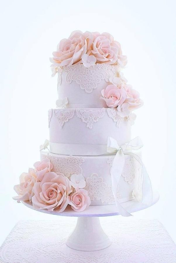 3 tier vintage style wedding cake with pale pink sugar roses. Lace wedding cake