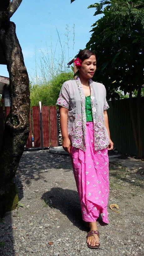 Embroidered kebaya and jumputan