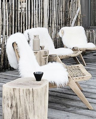 Fluffy sheepskins as outdoow seat covers - like the combination of the white with the pale wood