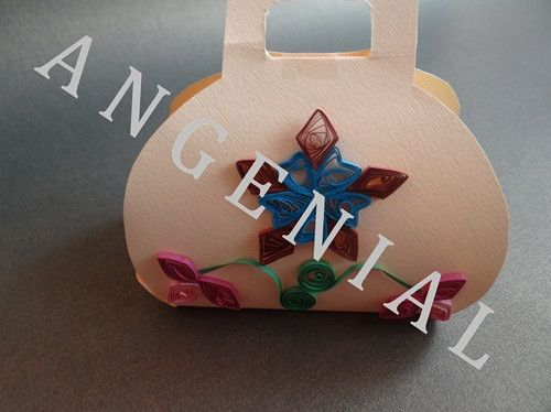"""Bag with a quilling flower"" is suitable for a non-standard and stylish box for your gift. Give a box of unique flowers to your loved ones and conquer the heart of every lady with its ingenuity."
