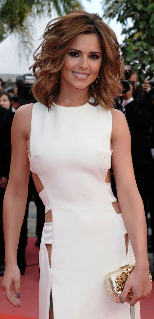 Cheryl Cole (Emma)  looking stunning on the red carpet think the hairstyle suits her very much in this one.