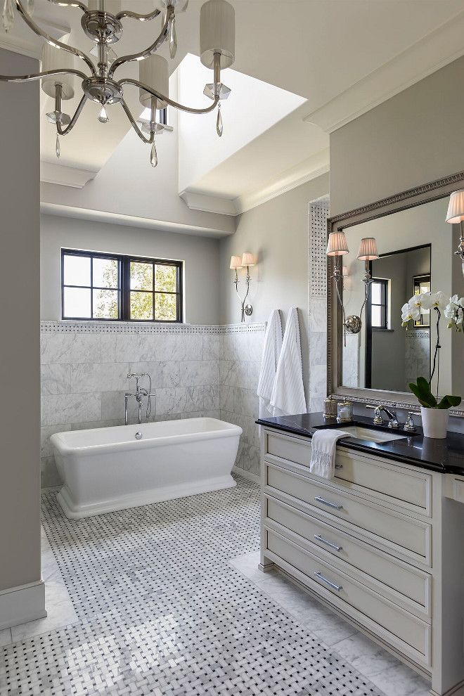 French Bathroom. This elegant grey French bathroom features custom vanity with soapstone countertop and marble basketweave floor tiles. #Frenchbathroom #Frenchinteriors #bathroom Hendel Homes